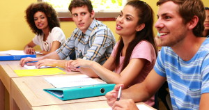 1396165872_stock-footage-students-sitting-in-a-line-listening-in-classroom-at-the-university